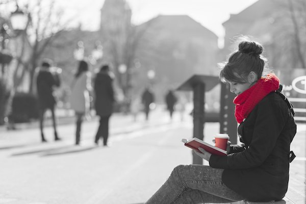 Women reading book in red