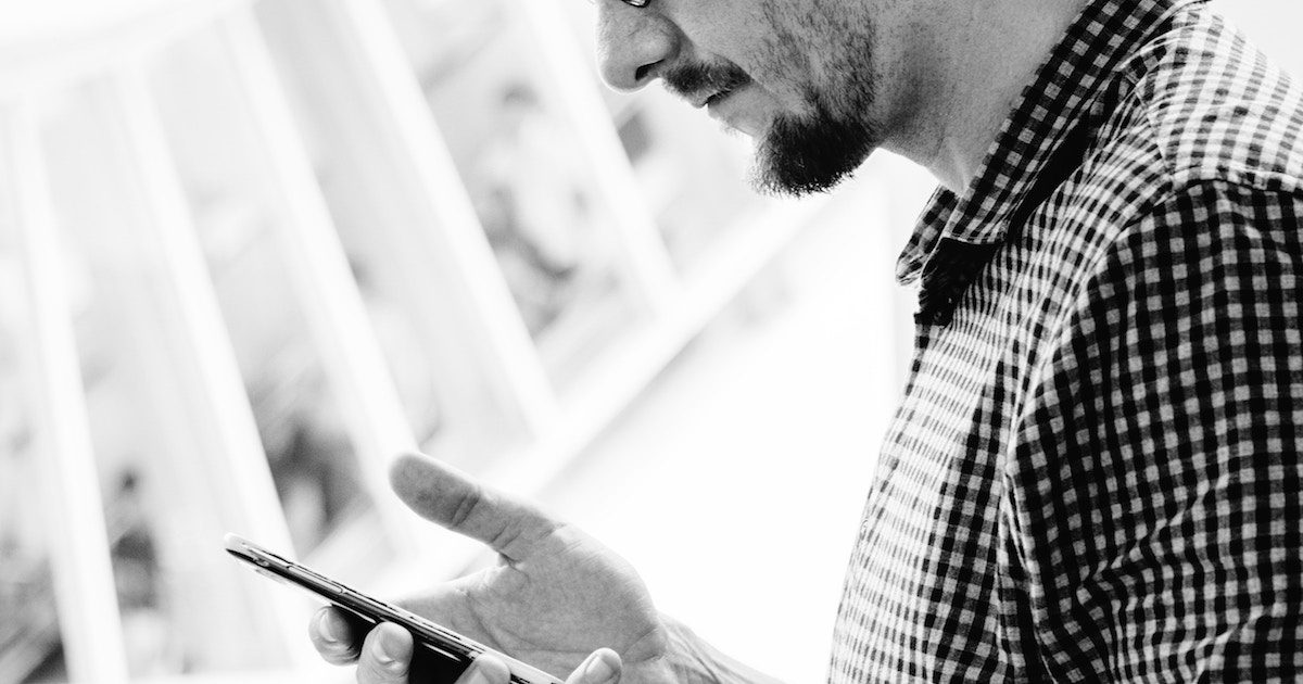 Man with mobile smartphone 1200x630pxl