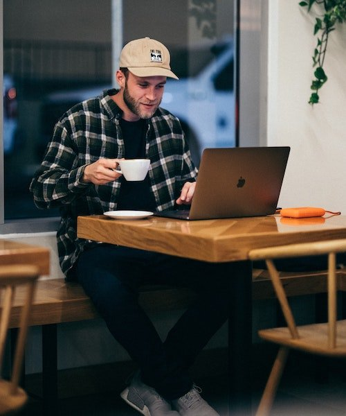 Man coffee cafe laptop kal-visuals-PFC2fY9LE_g-unsplash (1) 500x600pxl